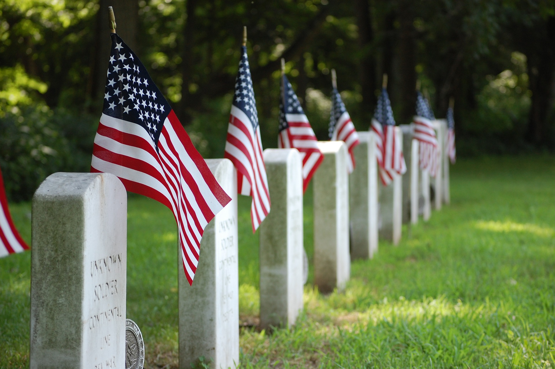 American flags beside veterans graves