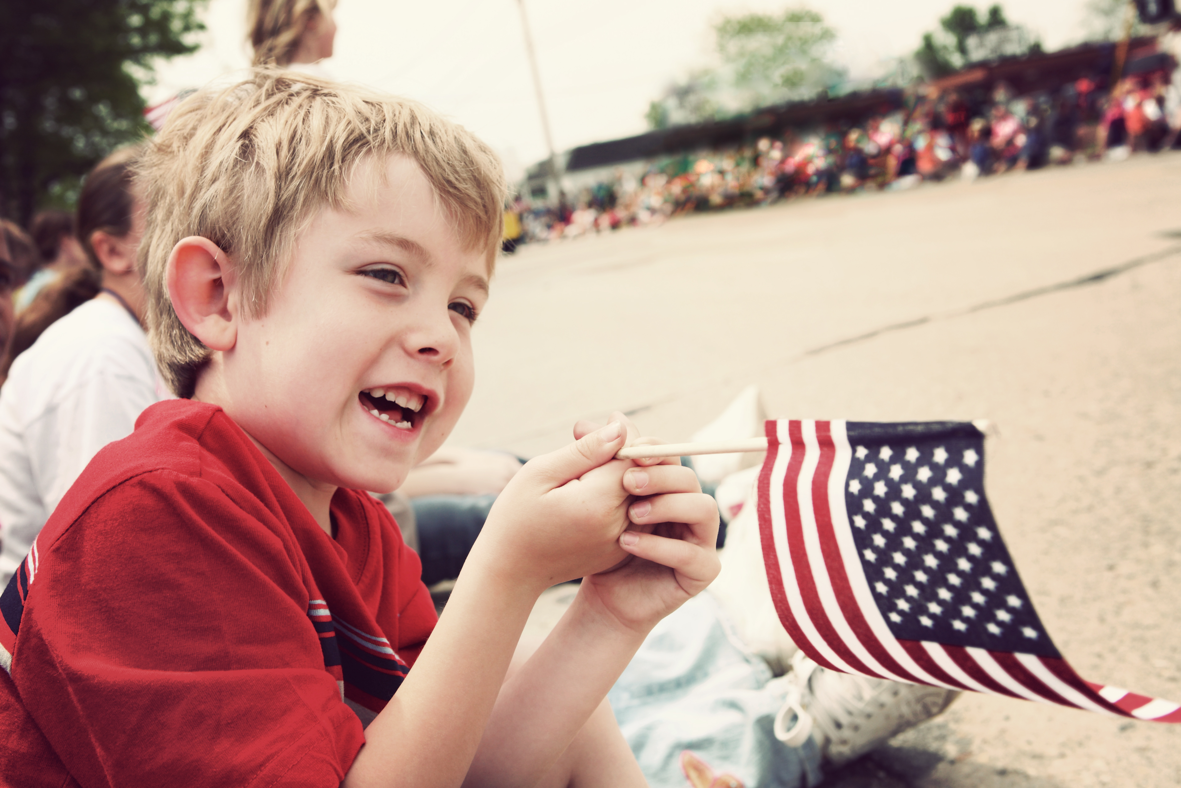 boy waving flag