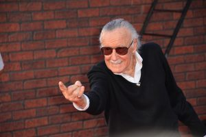 stan lee posing for photo at spiderman premier