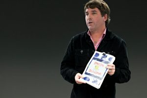 stephen hillenburg holding a spongebob squarepants comic