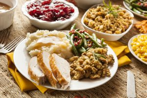 Thanksgiving dinner plate of turkey, potatoes, stuffing, gravy and green beans