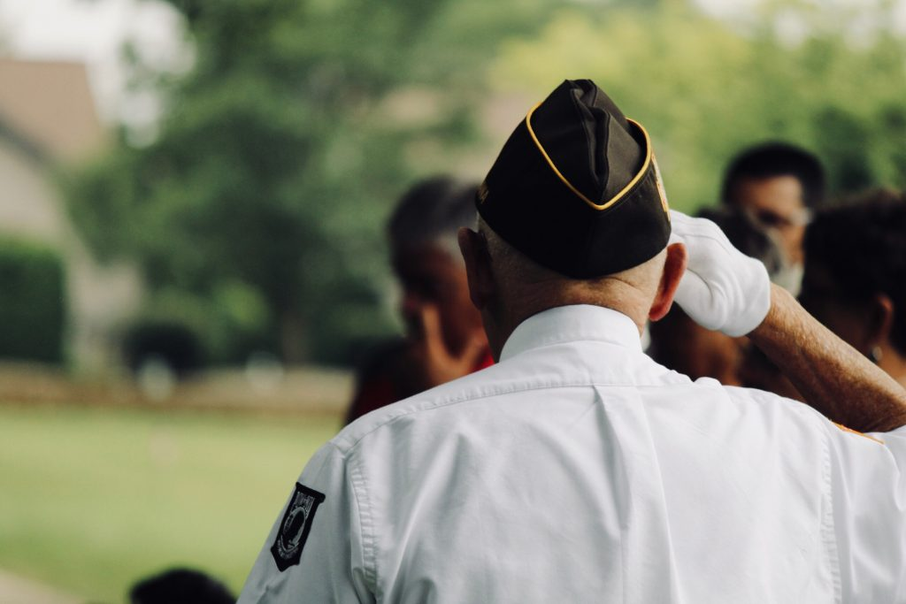 man in military uniforming saluting